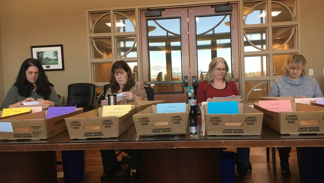 Redding employees Friday count ballots protesting rate hikes to garbage, sewer and water services.