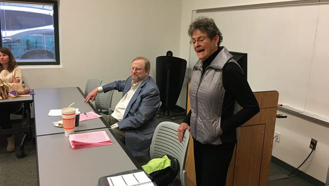 Clara Farah of the Creative Aging Advisory Committee introduces elderlaw expert Tom Dunlap at a CAAC meeting Friday.