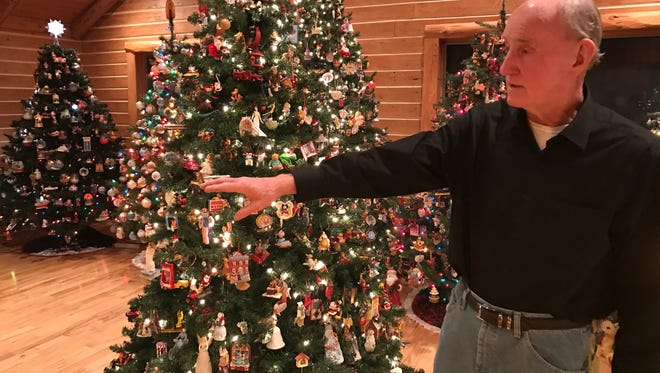 Homeowner Allen Kodet discusses his passion at the History of the Christmas Tree Walk in Algonac on Wednesday, Dec. 22, 2016.