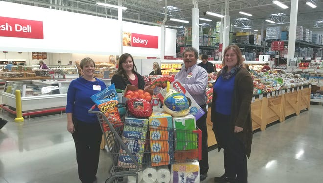 BJ's and Family Care Services played Santa this week. Left to right are Julie Konkle, operations manager, BJ's Wholesale Club; Andrea Adams, program director, Family Care Services; Chip Shott ,general manager, BJ's Wholesale Club; and Kristen Fisher, clinical director, Family Care Services.