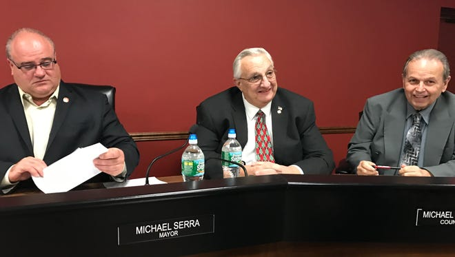 Longtime Pompton Lakes Councilman Michael Simone, center, at his final council meeting on Dec. 14.