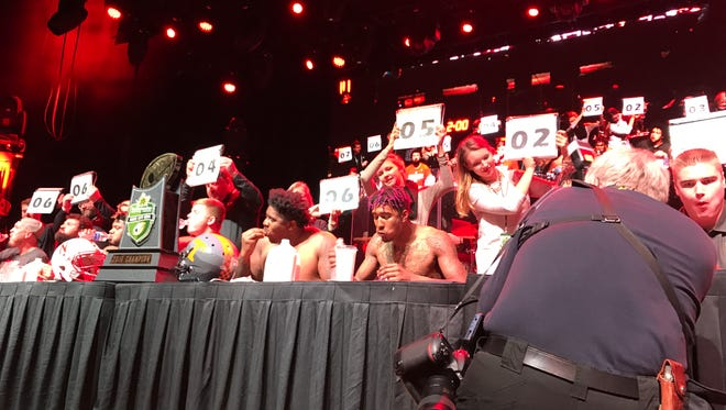 Tennessee and Nebraska competed in a hot chicken eating contest on Tuesday night at the Music City Bowl Welcome Party.