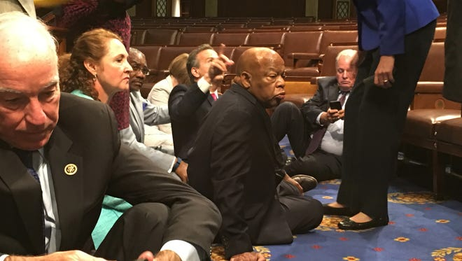 In this photo provided by Rep. John Yarmuth, D-Ky., Democratic members of Congress participate in sit-in protest on the floor of the House on June 22, 2016 seeking a vote on gun control measures.
