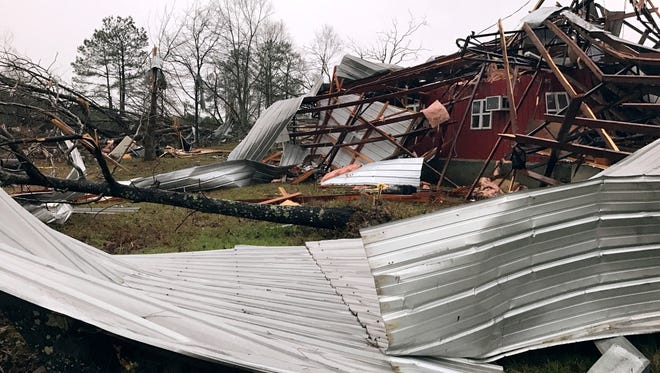 Debris lies on the ground after a storm south of Mount Olive, Miss., moved through the area Jan. 2, 2017.