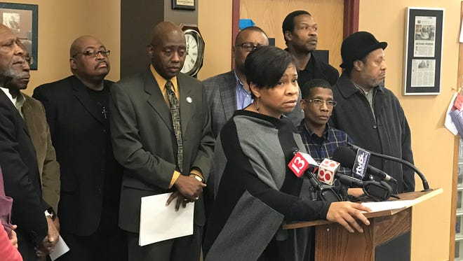 Indiana Black Expo President and CEO Tanya Bell addresses the media during an anti-crime call to action Thursday at the MLK Community Center.