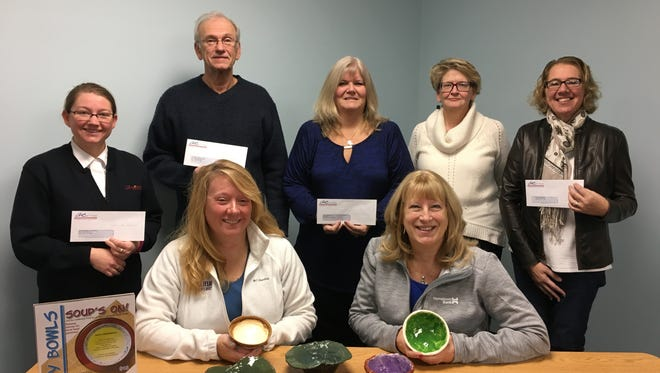 Five area food pantries were presented with proceeds from the 2016 Empty Bowls Fundraiser, an event of the Leadership Fond du Lac Alumni Group.  Each food pantry received a check for $1,534.  Pictured front row, from left: Empty Bowls Co-Chairs Tracy Qualmann, Marian University and Marcia Snyder, Hometown Bank. Back row, from left: Captain Telinda Wilson, Salvation Army; Mike Breszee, St. Vincent DePaul Pantry; Lindee Kimball, Loaves and Fishes board president; Lucy Summer, Broken Bread pantry coordinator; and Sarah Zimmerman, Fondy Food Pantry board president.