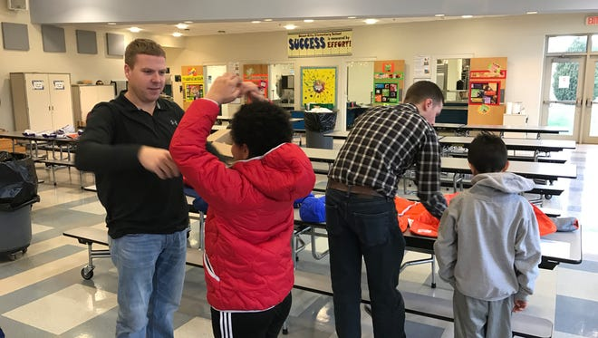Ocean City firefighters providing coats to kids in need, as part of Operation Warm.
