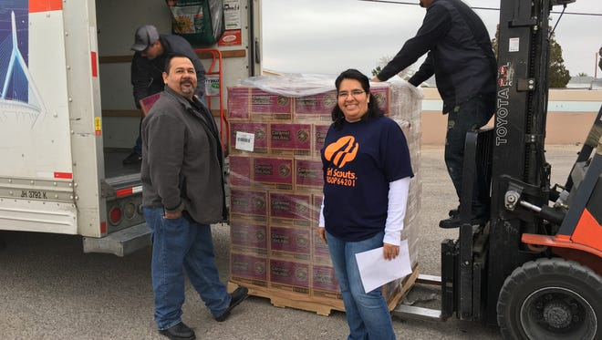 Mario and Gloria Santellano,  Girl Scout leaders, rented a U-haul to pick up 895 cases of cookies at the Coleman American Moving warehouse in Northeast El Paso.