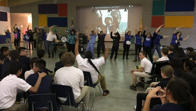 RMS faculty opened an anti-bullying assembly Friday with a stirring performance of YMCA.