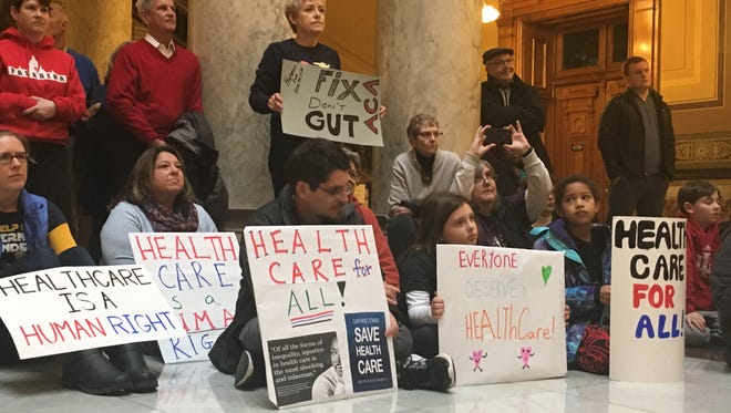 Around 1,000 people took to the Indiana Statehouse Jan. 15 to protest president-elect Donald Trump's plans to repeal the Affordable Care Act, which insures around 20 million people in the U.S.