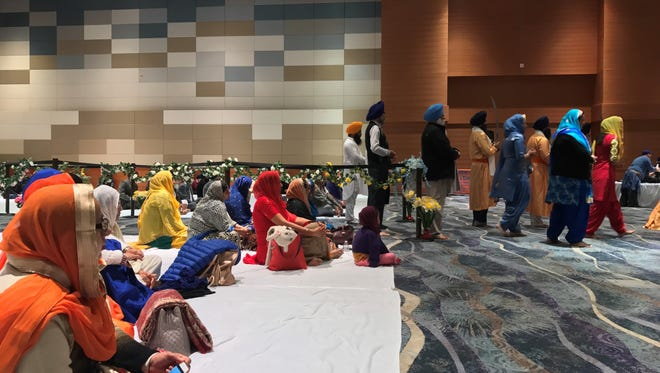 Sikh Sangat of Arizona members celebrate the 350th birthday of Guru Gobind Singh Ji, the father of Sikh identity. They are listening to live music, praying, and paying their respects in a ballroom at the Phoenix Convention Center on Jan. 15, 2017.