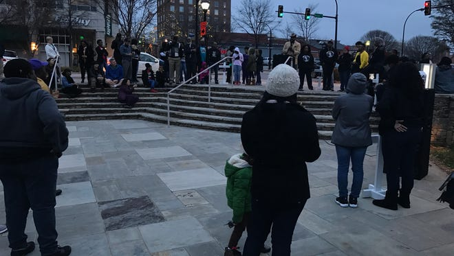 A crowd listens as speakers recall the loved ones they lost to violence during rally on MLK day. Jan. 16, 2017