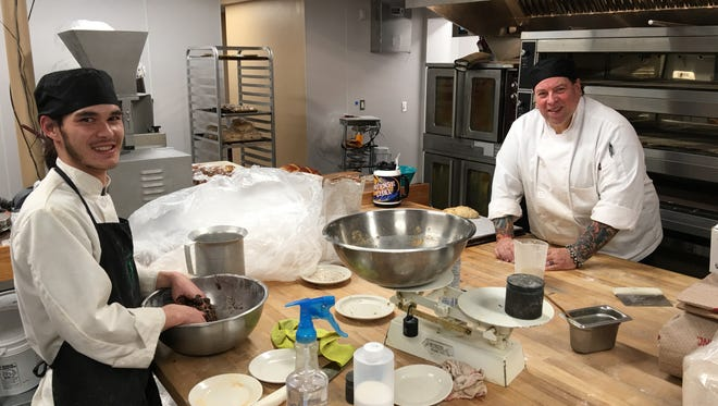 Bakers Caiden Carter, left, and Bob McCullock work on tomorrow's loaves in the Cornerstone's dramatically expanded bakery kitchen. The pair hold two of the 26 new jobs created when the cafe moved to its larger location.