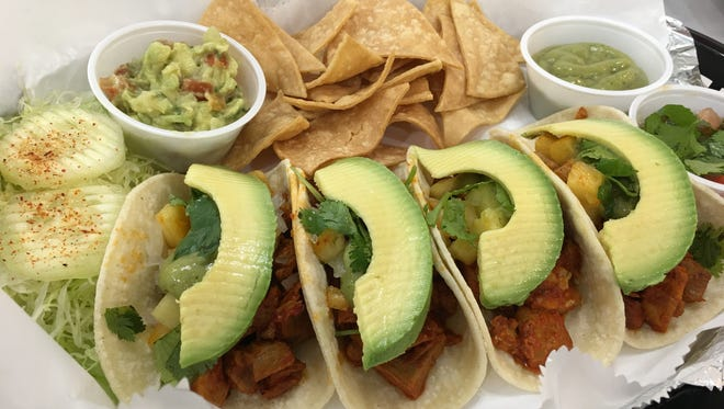 This is what an order of tacos al pastor looks like at Las Tortugas taqueria.