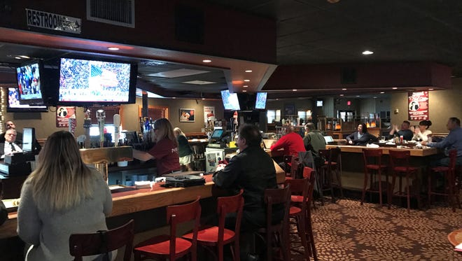 The scene at the Office Restaurant & Lounge in downtown Toms River when President Donald Trump completed the oath of office and became the nation's 45th chief executive on Friday.
