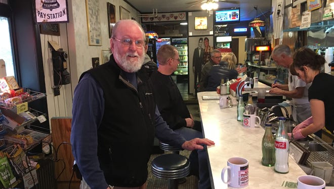 Obie Kline, a Wilmington shop owner, ate breakfast at Angelo's Diner Friday as the presidential inauguration was broadcast on a television in the corner. He voted for Trump because he was fed up with longtime politicians in Washington, D.C., he said.