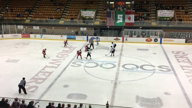 The Port Huron Flags and Hamilton (Ont.) Huskies face off in the third period at McMorran Arena Thursday.