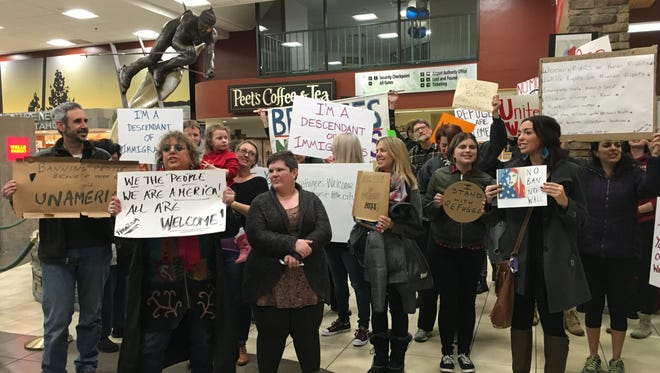 A group of people protested President Trump's executive order at the Reno-Tahoe International Airport Saturday, Jan. 28, 2016.