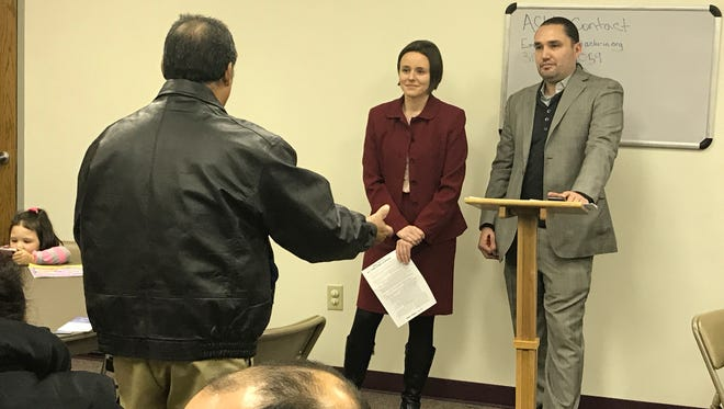 """Attorneys Emma Mahern and Kevin C. Muñoz listen as a man originally from Mexico who has been living in the United States for 17 years expresses his concerns of deportation  under the presidency of Donald Trump. The man's remarks were part of a """"Know Your Rights"""" forum held for immigrants Sunday at St. Monica Catholic Church."""