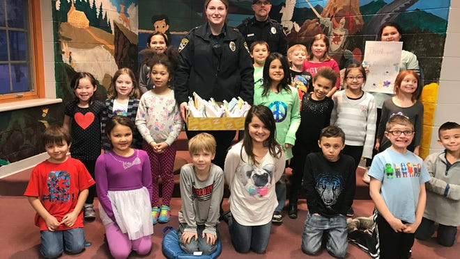 Students in the Kindness Rocks class at Jefferson Community Learning Center (pictured), a before-and-after-school program at Jefferson Elementary School. The students created treat bags for all 64 members of the Manitowoc Police Department and presented the bags to officers Jan. 30.