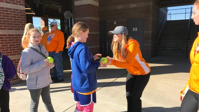 """Tennessee junior Scarlet McSwain signs an autograph for a young fan at Tennessee softball's """"Meet and Greet"""" on Saturday afternoon."""