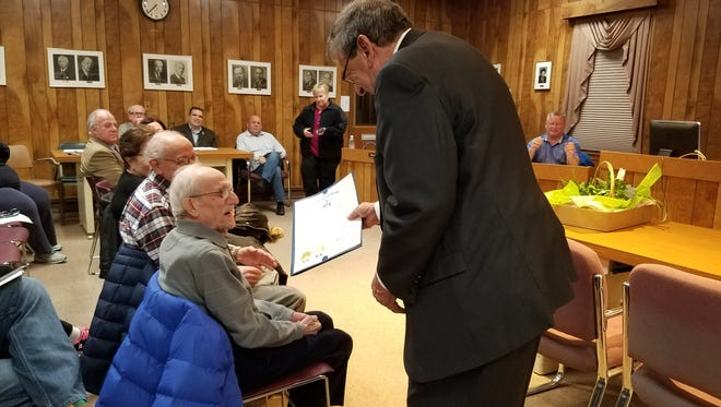 Senator Gerald Cardinale, right, hands Frank Lucia, who will turn 107 on Feb. 8, a proclamation in honor of his upcoming birthday during the Feb. 7 mayor and council meeting.
