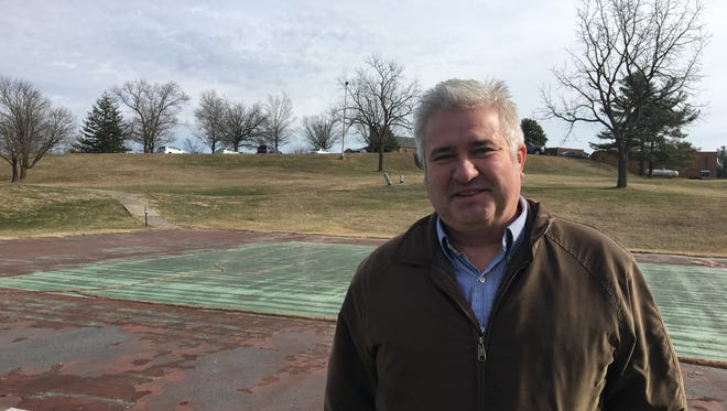 John Huggins stands on the new site of the Shenandoah Valley Blues and Brews Festival, which will be held at The Club at Ironwood in Staunton.