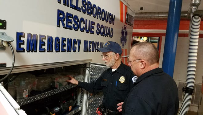 EMTs Buz Fried and Stan Kosinski inspect the quipment on one of the Hillsborough Rescue Squad's rigs.