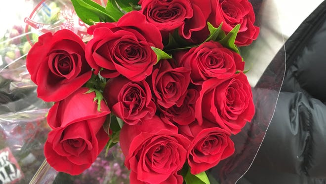Roses at Trader Joe's are $12.99 a dozen.