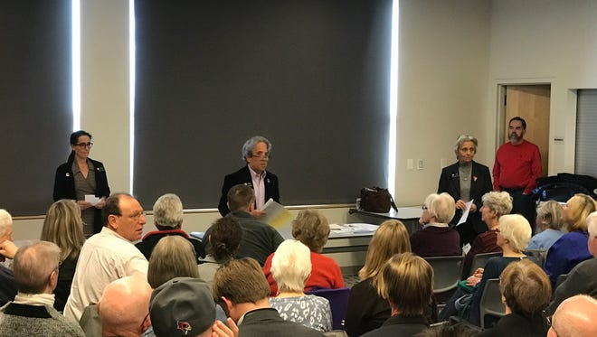 Rep. Jeni Arndt, Sen. John Kefalas and Rep. Joann Ginal address a packed meeting room Saturday at Council Tree Library in Fort Collins.