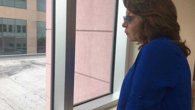Tears stream down Isabel Martinez's cheeks as she stares out a window in the Lee County justice center after a custody hearing Tuesday. Martinez spoke about her daughter, Heyzel Obando, who was killed a year ago.