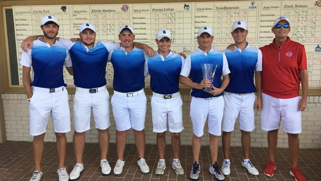 UWF men's golf coach Steve Fell (far right) joins his team after their record-setting victory Tuesday in Lakeland at the Matlock Collegiate Classic. Argos are ranked No. 1 in NCAA Division II pol..