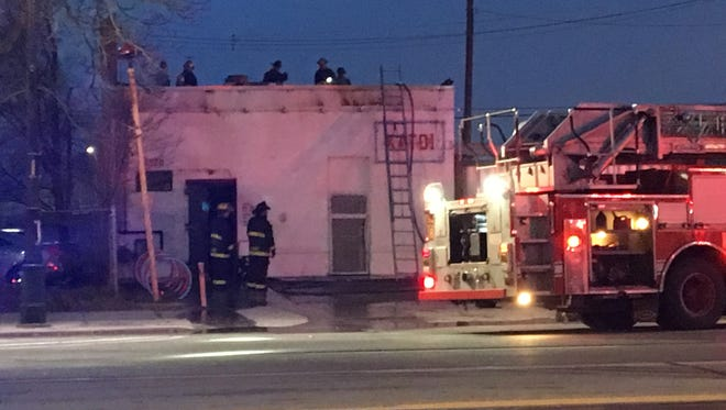 Detroit Fire Department crews responding to flames at Katoi restaurant this morning.