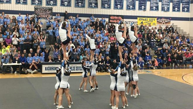 The Richmond High School cheer team performs its third routine Friday night.