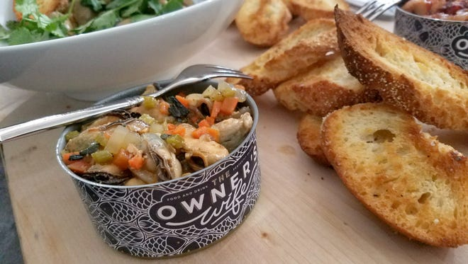 The mussels escabeche, canned in-house at The Owner's Wife, are tender, tangy and addictive. The team also house-cures meats, prepares homemade cheeses and brews beer vinegar. The Owner's Wife opens Feb. 26, 2017, at 608 N. Park Ave. in Downtown Indianapolis.