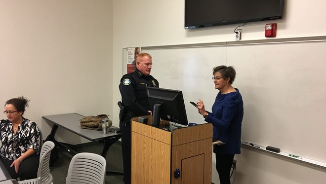 Police chief Darren Hooker chats with Clara Farah, head of the Creative Aging Advisory Committee before his presentation on common senior scams.