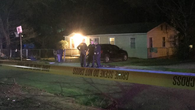Officers from the Anderson Police Department work outside of a home on Martin Avenue after a Tuesday shooting.