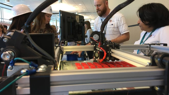 Ben Green explains the process of the Fushion F306 3-D printer at Y-12's Introduce a Girl to Engineering event Thursday, Feb. 23.