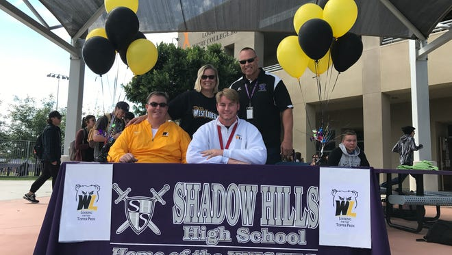 Shadow Hills senior T.J. Lew signed his national letter of intent Feb. 21 to play football for West Liberty next fall.