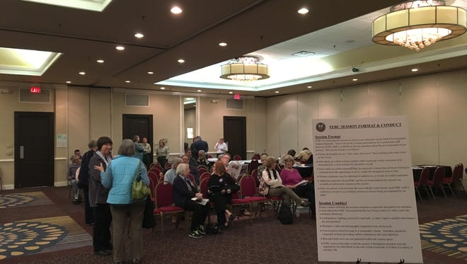 Citizens wait to submit official comments on the proposed Atlantic Coast Pipeline to FERC officials at a listening session event at the Holiday Inn in Staunton, Va., on Thursday, Feb. 23, 2017.