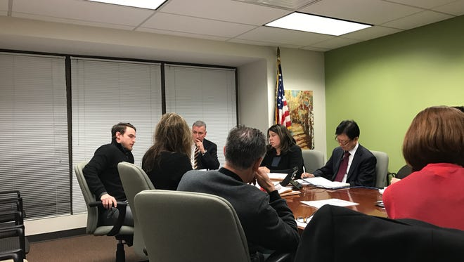 Englewood Cliffs Chief Financial Officer Chris Battaglia and Borough Auditor Paul Garbarini discuss the 2017 budget with members of the Borough Council at a special meeting Monday.