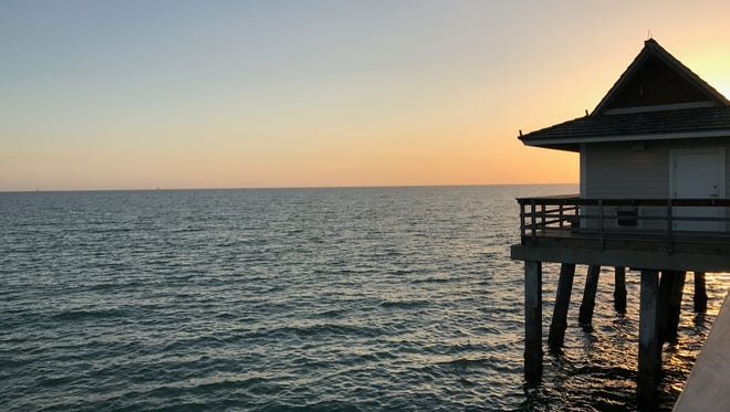 The view from Naples Pier during sunset. The little building is a snack shack open for the convenience of the Pier's visitors.