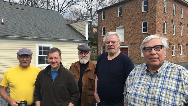 Staunton Makerspace members (from left to right) Rick Hubbard, Dan Funk, Gene Provenzo, Nelson Patterson and Jim Rutt look toward the future the day after a fire on Feb. 28, 2017, heavily damaged their Staunton office.