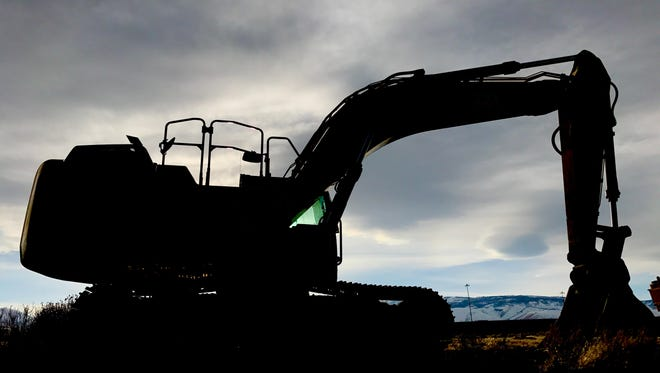 Construction equipment just before sunset at the Summit Club Apartments site near The Summit Reno mall.