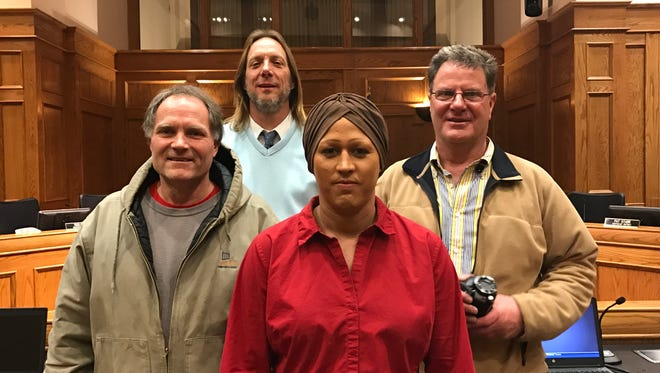 From left: Tim Stanga. David Zokaites, Sierra Broussard and Bruce Danielson pose for a photo inside the City Council chambers at Carnegie Town Hall Tuesday, March 7.