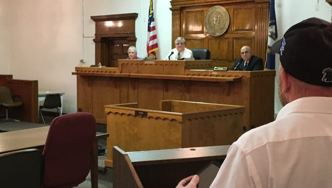 Grant County resident Myron Miller vents his frustration Thursday night to Judge-executive Steve Wood and the Grant County Fiscal Court in the fiscal court chambers. The fiscal court voted to raise taxes on workers 2 percent.