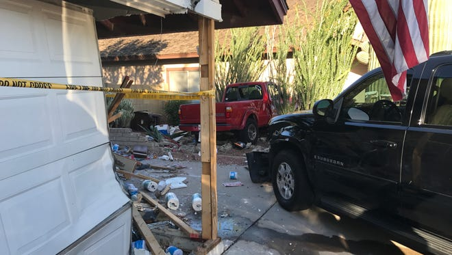 Shane Rock was arrested on suspicion of drunk driving after he drove his truck into a house in Peoria on March 9, 2017.
