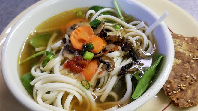 Vegan means healthy and flavorful. This udon soup in a vegetable broth with carrots, mushrooms and scallions was recently featured at Common Ground Community Kitchen.