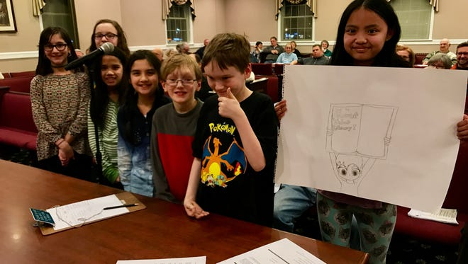 Children asking Parsippany Town Council for longer hours for their Mount Tabor Library. The hours were cut in February, shutting the library at 5 p.m. Children inlcude Ava Cohen, 12, Sofia Rodriguez, 12, Rhaya Lau, 11, Maya Lau, 9, Charlie Davis, 11, Ian Davis, 12 and Lilly Go, 12.