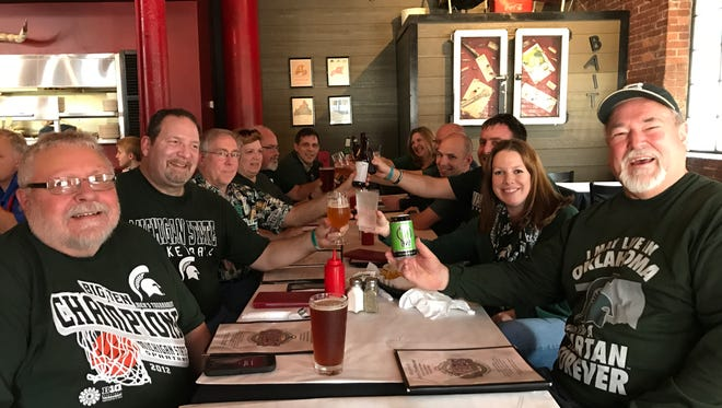 MSU alumni from Oklahoma and Arkansas gather at Caz's Chowhouse in Tulsa before the MSU men's basketball team plays in the opening round of the NCAA tournament.